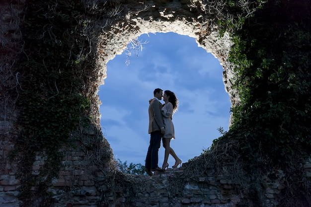 Couple standing on a rock hole