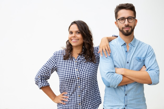 Couple standing together and smiling at camera