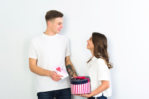 Couple standing with gift and greeting card