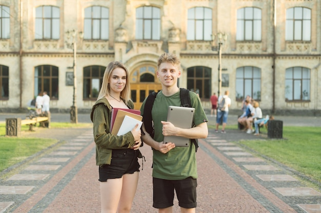 Couple of students standing near college