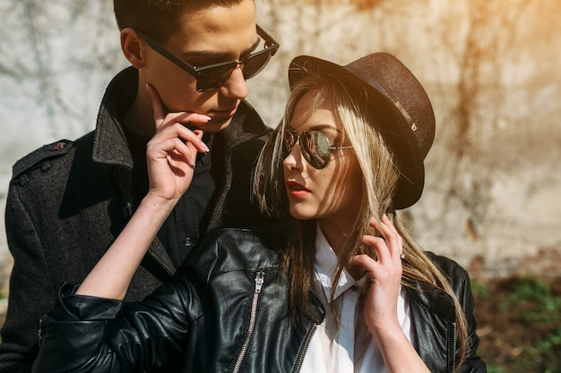 Couple in sunglasses and hat