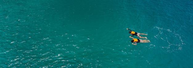 Couple swim in sea