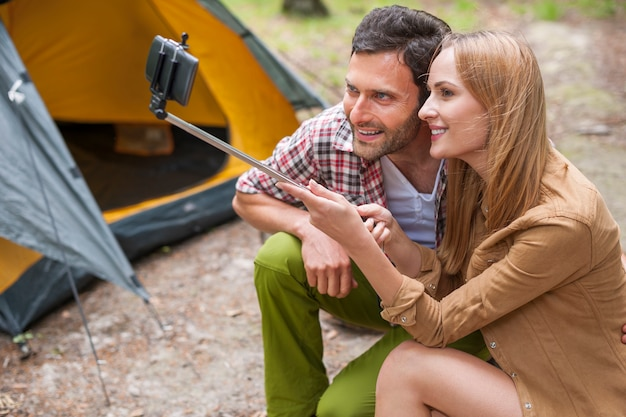 Couple taking a photo in the camping