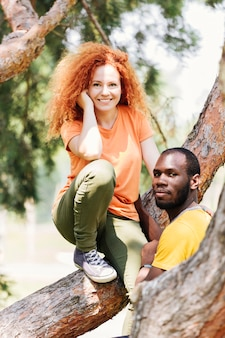 Couple taking pictures on a tree