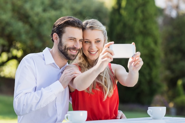 Couple taking a selfie on mobile phone