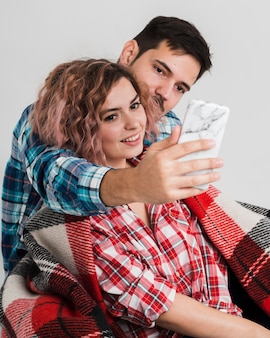 Couple taking selfie for valentines