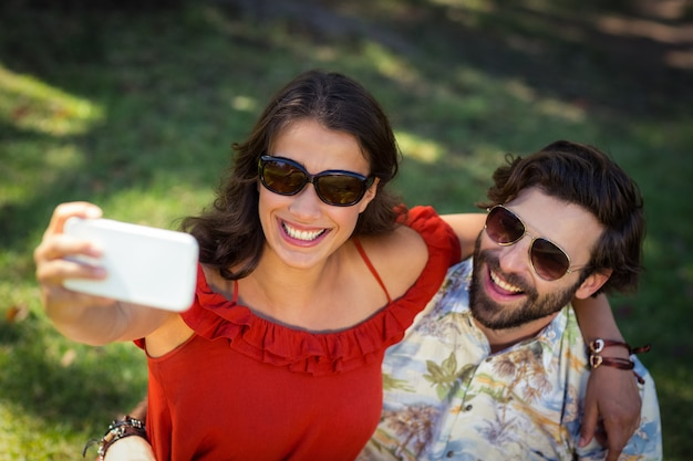 Couple taking selfie with mobile phone