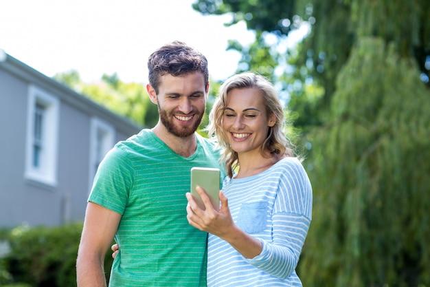 Couple taking selfie in yard