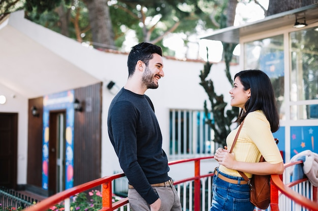 Couple talking in a theme park