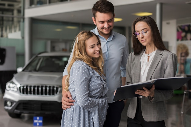 Couple talking with a car dealer