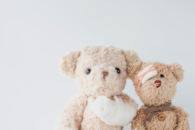 Couple teddy bears are playful and got accident