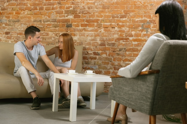 Couple in therapy or marriage counseling. psychologist, counselor, therapist or relationship consultant giving advice. man and woman sitting on a psychotherapy session. family, mental health concept.
