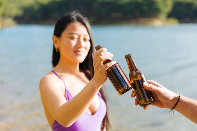 Couple toasting with bottles of beer