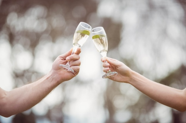 Couple toasting with champagne outside