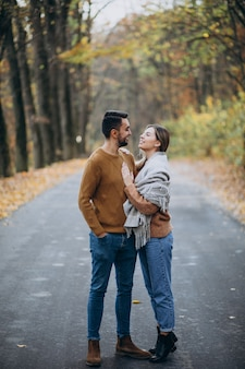 Couple together in park covered in blanket