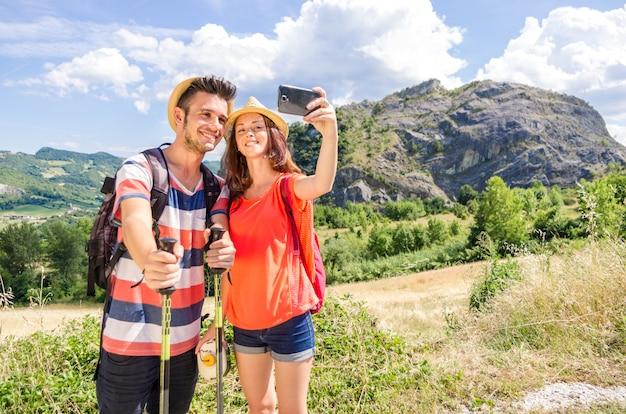 Couple of tourist takes selfie during their excursion