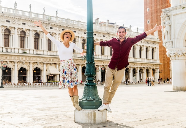 Couple of tourist visiting piazza san marco, italy