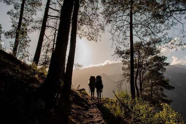Couple of tourists hiking in woods in goynuk canyon