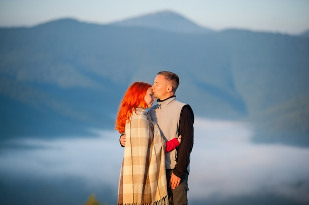 Couple tourists kissing and hugging each other
