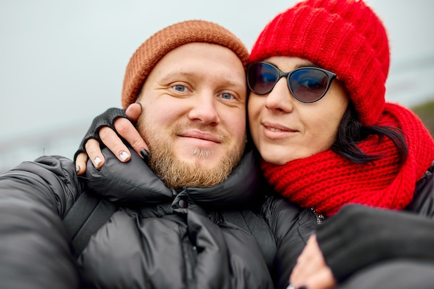 Couple of tourists take selfie at the mountain