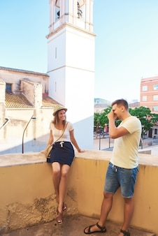Couple of tourists walking in historical quarter of spain