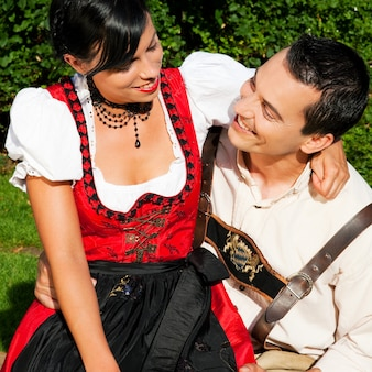 Couple in traditional bavarian dress in summer