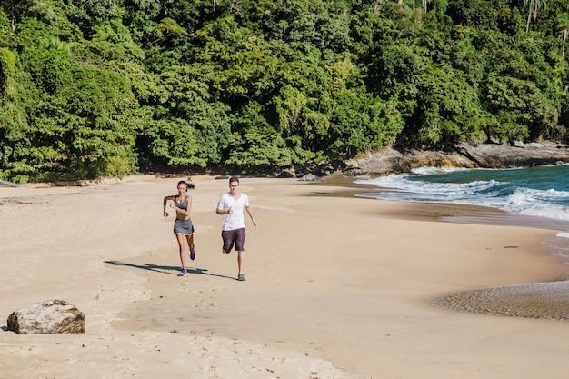 Couple training on the beach