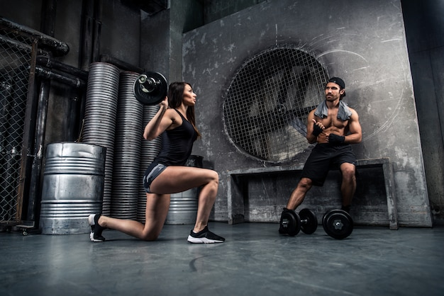 Couple training in a gym