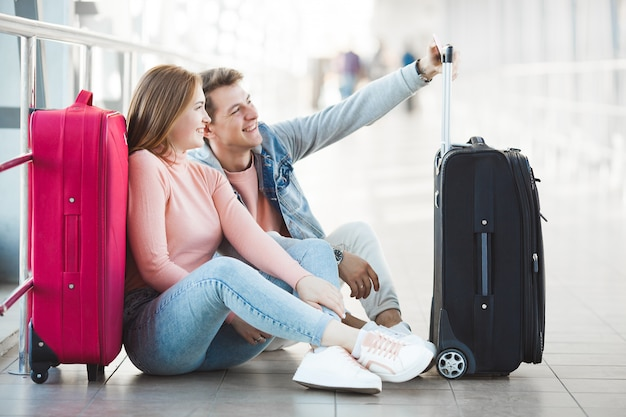 Couple traveling. lovers journey. young man and woman in the airport. family tour.