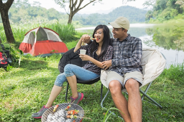Couple traveling and spending time while camping