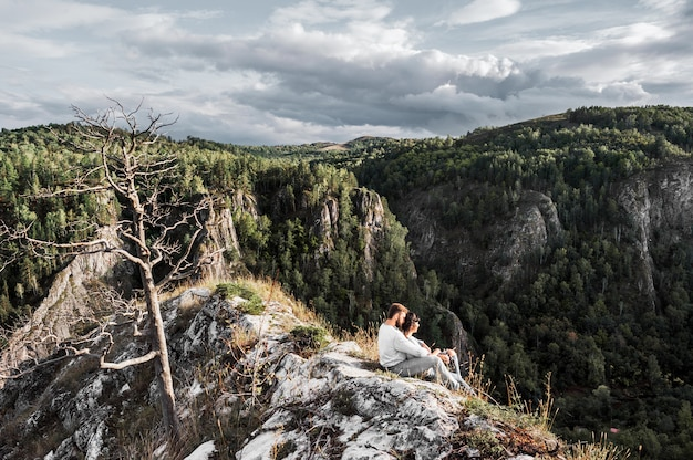 Couple traveling through the mountains. couple in love in the mountains. man and woman traveling. a walk in the mountains. lovers relax in nature. hiking in the mountains.