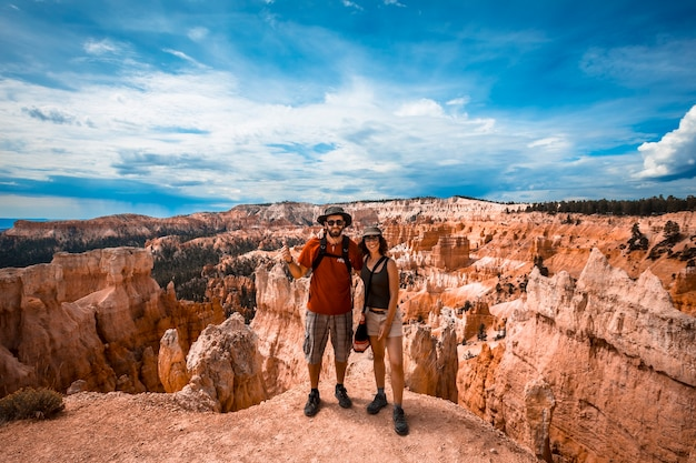 A couple trekking on the queens garden trail in bryce national park, utah. united states