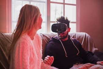 Couple trying on VR glasses