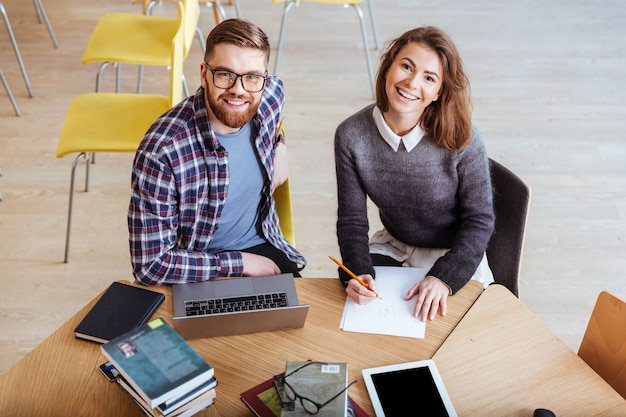 Couple using laptop and working together