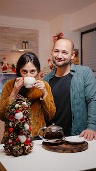 Couple using video call communication on christmas eve