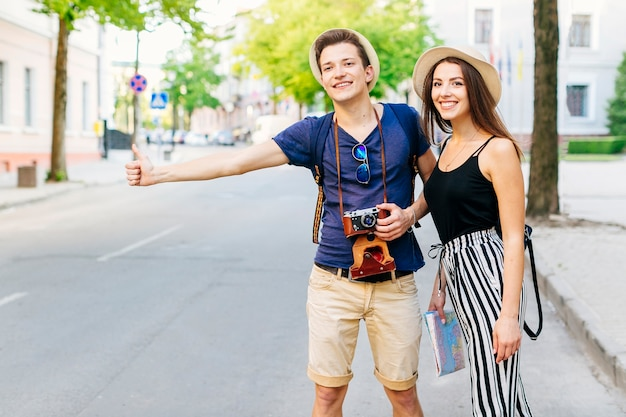Couple on vacation waiting for taxi