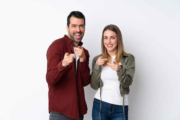Couple in valentine day over isolated wall points finger at you