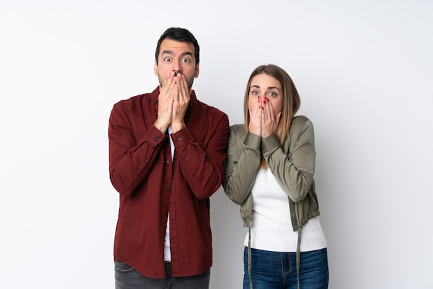 Couple in valentine day over isolated wall with surprise facial expression