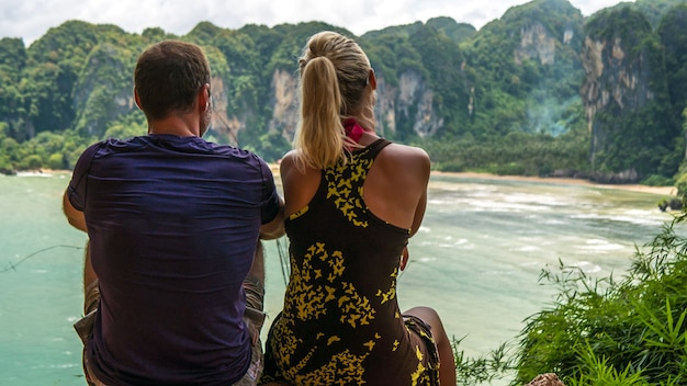 A couple on view point t hat tom sai beach at railay near ao nang, krabi, thailand.