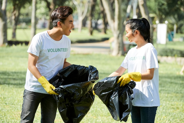 Couple of volunteers picking up the garbage
