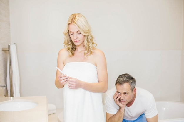 Couple waiting for a pregnancy test results in the bathroom