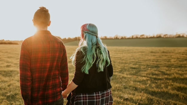Couple walking and holding hands outdoors