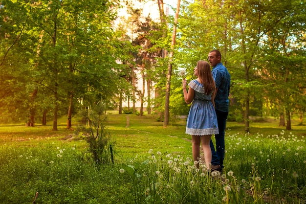Couple walking in spring forest