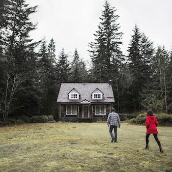 Couple walking towards cabin