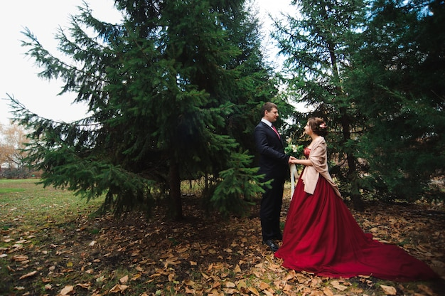 Couple walks in the park. the couple in the autumn forest