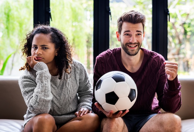 Couple watching a football game