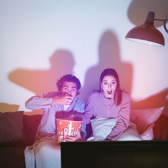 Couple watching a horror movie