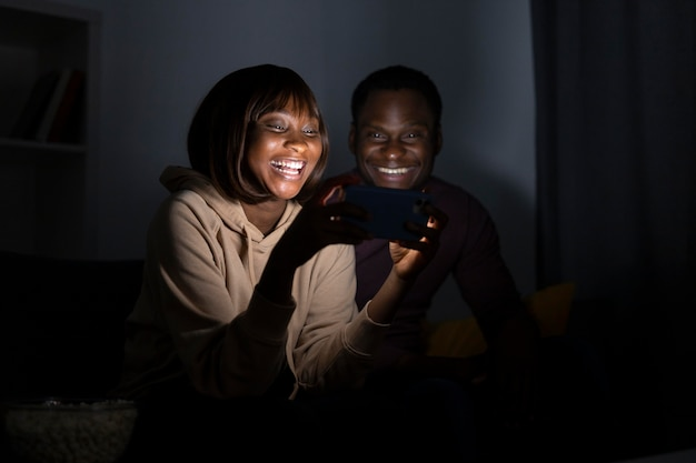 Couple watching netflix together at home
