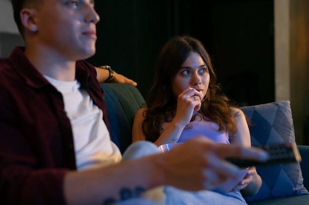 Couple watching netflix together indoors