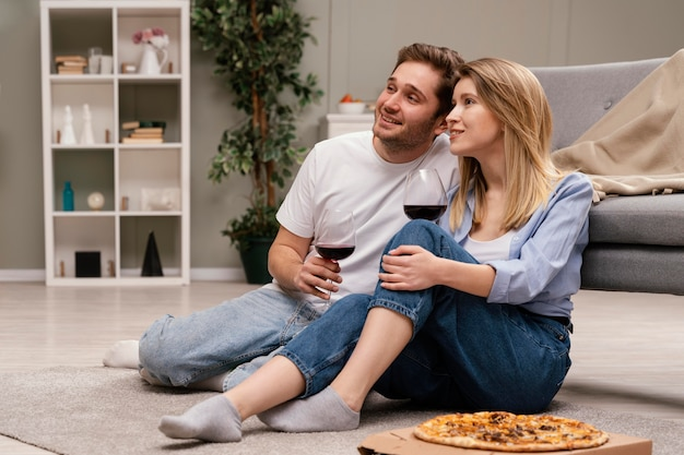 Couple watching tv and drinking wine